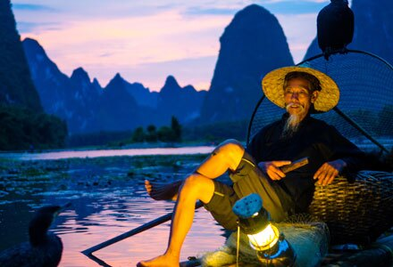 Fisherman on Li River in Guilin